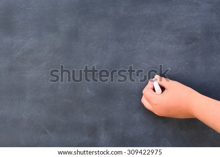 Hand writing on the blackboard at school.