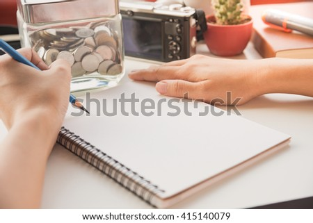 hand writing on the paper with financial planning concept. - stock photo
