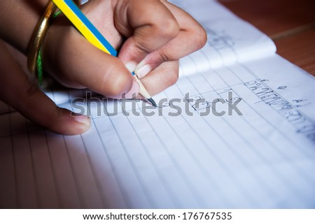 Hand writing on the sheet. - stock photo