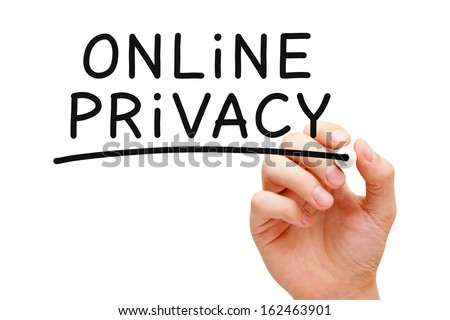 Hand writing Online Privacy with black marker on transparent wipe board. - stock photo