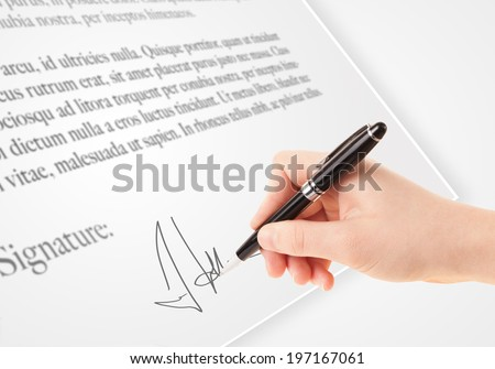 Hand writing personal signature on a legal paper  - stock photo