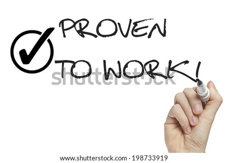 Hand writing proven to work on a white board with check mark - stock photo