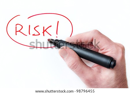 Hand writing Risk on whiteboard - stock photo