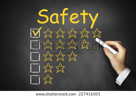 hand writing safety on black chalkboard golden star rating - stock photo