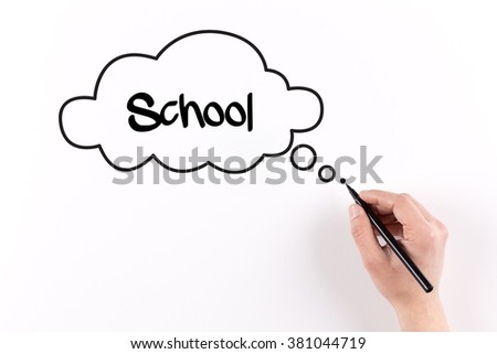 Hand writing School on white paper, View from above - stock photo