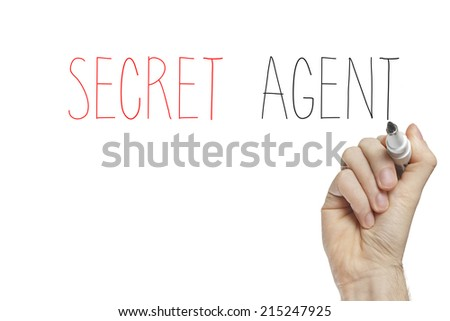 Hand writing secret agent on a white board
