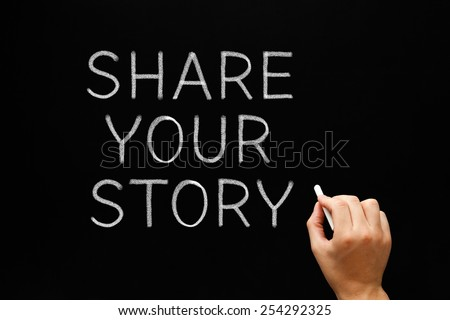 Hand writing Share Your Story with white chalk on a blackboard. - stock photo