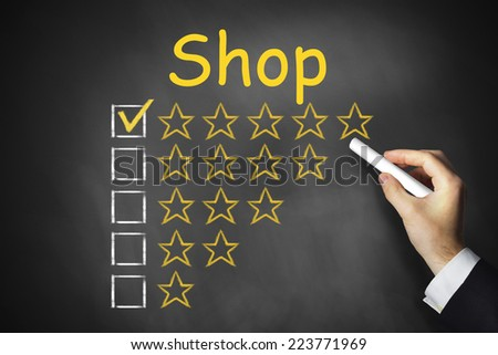 hand writing shop on chalkboard golden rating stars