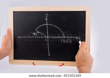 Hand writing solution to maths problem on board - stock photo