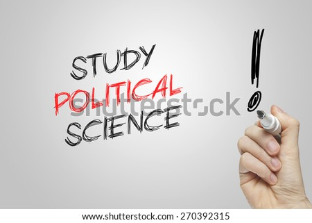 Hand writing study political science on grey background - stock photo