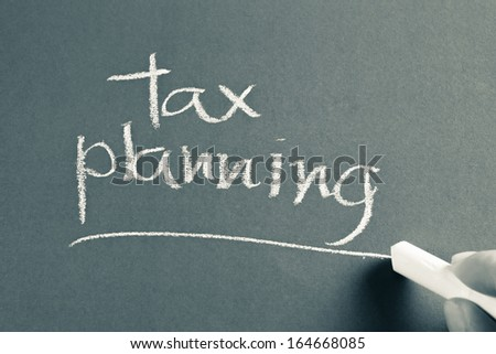 Hand writing Tax Planning word with chalk - stock photo