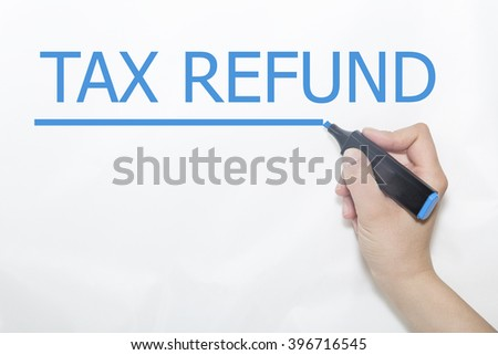 Hand writing tax refund with blue marker on transparent wipe board.