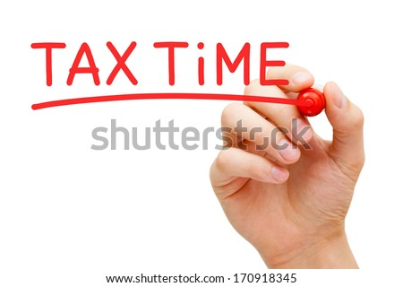 Hand writing Tax Time with red marker on transparent wipe board. - stock photo