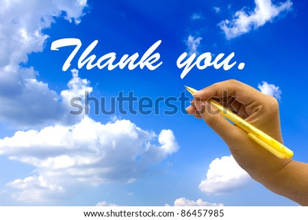Hand writing thank you on blue sky. - stock photo
