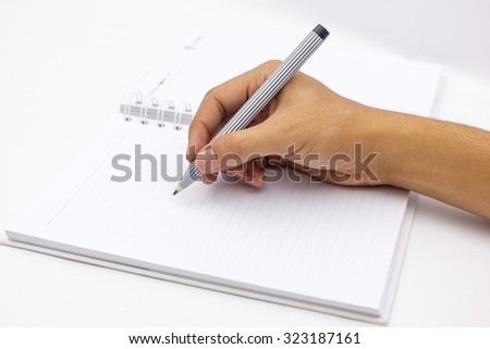 hand writing the blank notepad