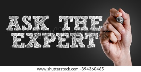 Hand writing the text: Ask the Expert - stock photo