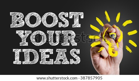 Hand writing the text: Boost Your Ideas - stock photo