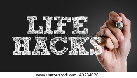 Hand writing the text: Life Hacks - stock photo