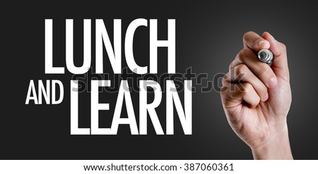 Hand writing the text: Lunch and Learn - stock photo