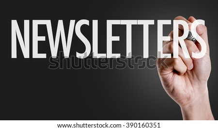 Hand writing the text: Newsletters - stock photo