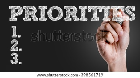 Hand writing the text: Priorities - stock photo