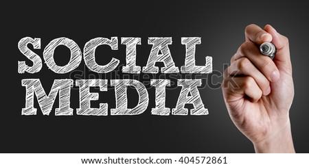 Hand writing the text: Social Media - stock photo