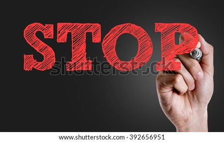 Hand writing the text: Stop - stock photo