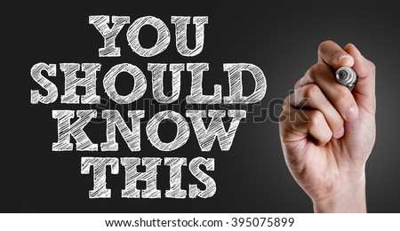 Hand writing the text: You Should Know This - stock photo
