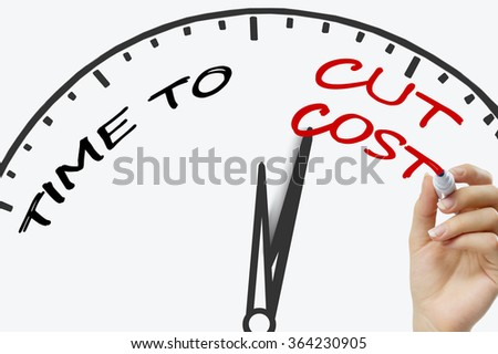 Hand writing Time to Cut Cost concept with red marker on transparent wipe board. - stock photo
