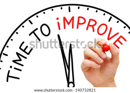 Hand writing Time to Improve concept with red marker on transparent wipe board. - stock photo