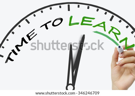 Hand writing Time to Learn concept with blue marker on transparent wipe board. - stock photo