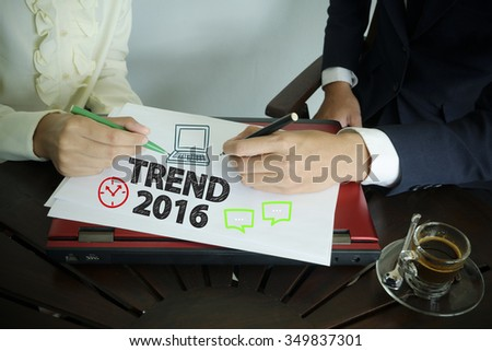 hand writing TREND 2016 text with two business person ,team work concept - stock photo