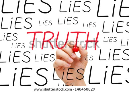 Hand writing Truth with red marker between many Lies on transparent wipe board. - stock photo