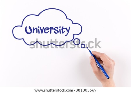 Hand writing University on white paper, View from above - stock photo