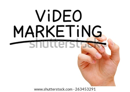 Hand writing Video Marketing with black marker on transparent wipe board. - stock photo