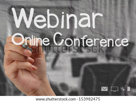 hand writing Webinar with crumpled paper background as concept - stock photo