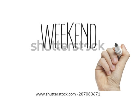 Hand writing weekend on a white board - stock photo