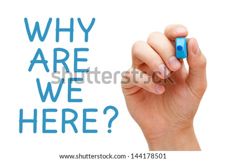Hand writing Why Are We Here with blue marker on transparent wipe board.