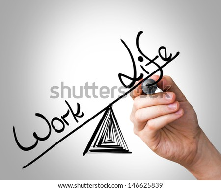 Hand writing with a black mark on a transparent board - Work, Life - stock photo