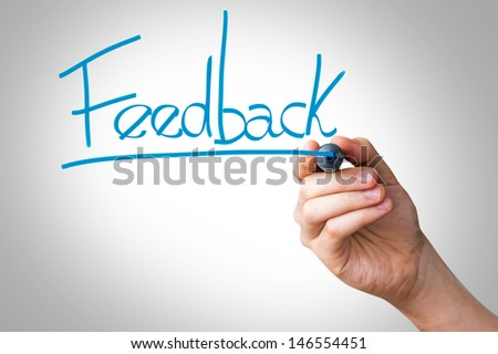 Hand writing with a blue mark on a transparent board - Feedback - stock photo