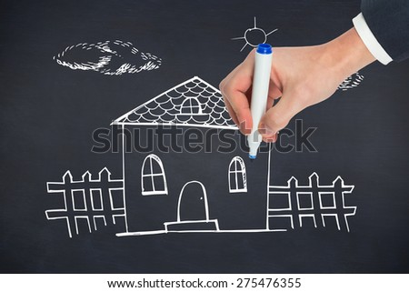 Hand writing with a marker against black background