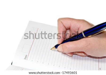Hand writing with a pen, on a blank notebook. Isolated on white background