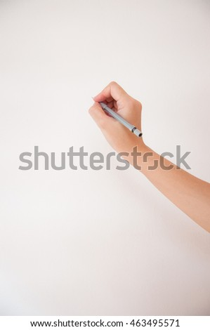hand writing with a pencil. isolated on white background.