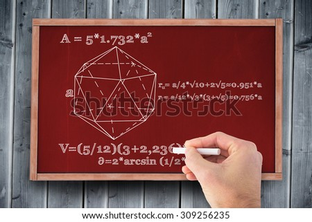 Hand writing with a white chalk against blackboard with copy space on wooden board - stock photo
