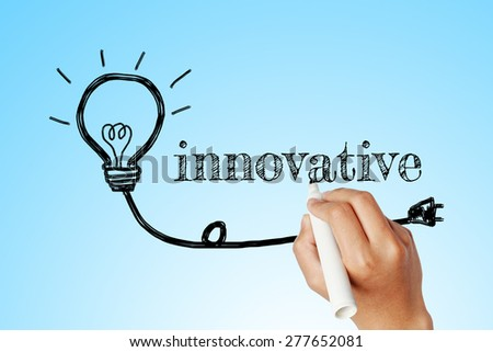 hand writing word of innovative with lightbulb background