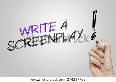 Hand writing write a screenplay on grey background - stock photo
