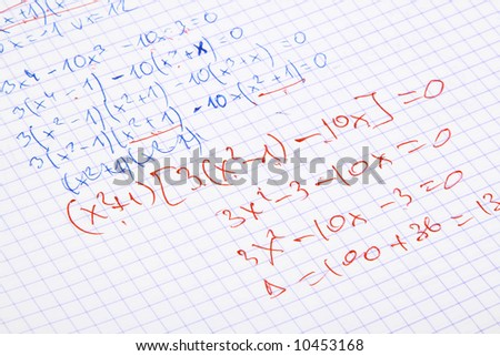 hand written maths calculations with teacher's corrections in red - stock photo
