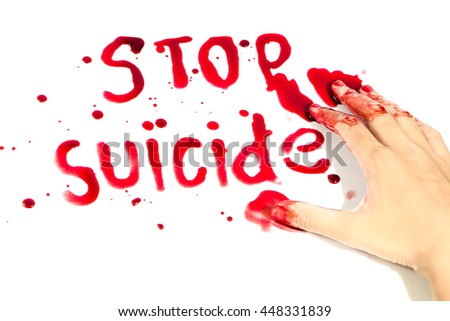 Hand-written message Stop Suicide with blood.
