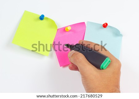 Hand written notes a green marker on a red sticker on a white board from notice  - stock photo