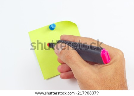Hand written notes a red marker on a green sticker on a white board - stock photo